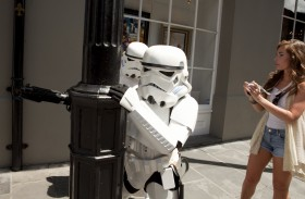 Stormtroopers take cover behind an ornate lamp post in the French Quarter
