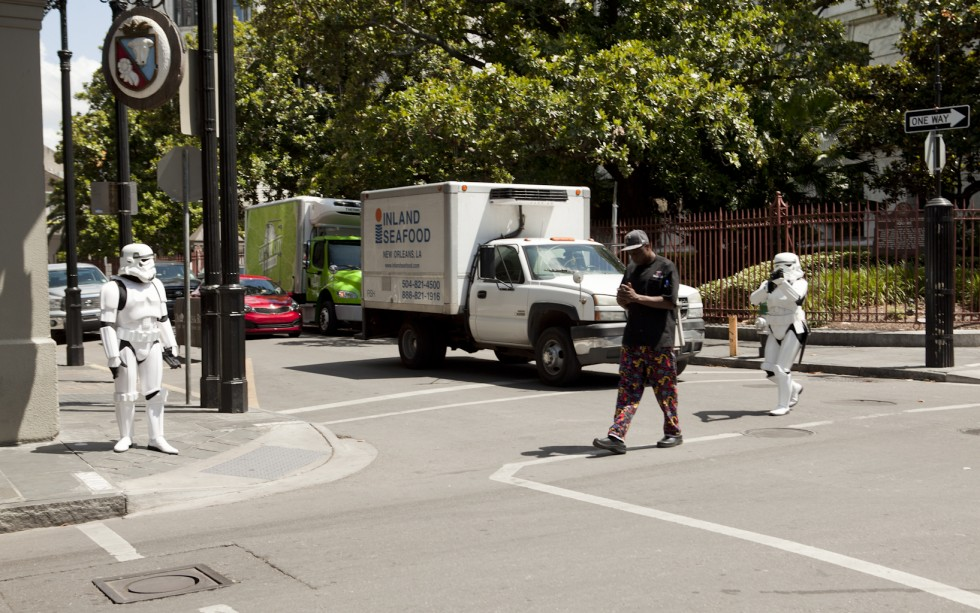 Storm Troopers shadow an oblivious man crossing a street